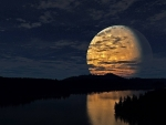 big moon over a river
