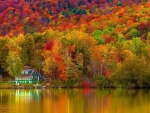House on autumn lake