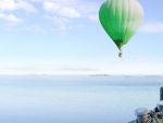 Green balloon over the sea
