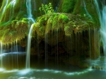 Water Flows Over Moss Covered Rocks