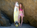 Model Posing with a Surfboard