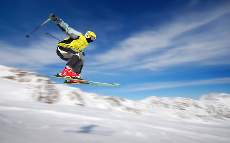 Extreme Skiing - skies, ski, skiing, blue, air time, extreme, clouds, snow, mountains, winter