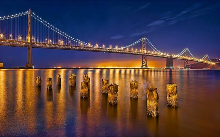 Sparkling Golden Bridge - glow, bridge, river, reflection, pillars, golden, lighting