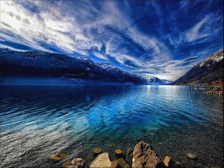 BLUE MOUNTAINS WITH CLOUDS - skies, blue, lake, clouds, stones, water, mountains, rocks