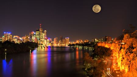 City Lights - peaceful, trees, house, view, road, lights, moon, colors, houses, full moon, city, skyscrapers, night, beauty, lanterns, streets, colorful, architecture, buildings, beautiful, river, sky, skyline, reflection