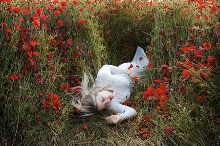 Sleeping in a field of poppies - girl, red, field, poppies