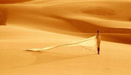 Across desert - female, lonely, sahara, alone, model, desert, wind, veil