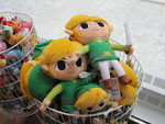 Toon Links and Yoshi's in a basket