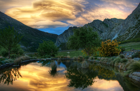 Sunset-HDR - cool, pleasant, lake, beautiful, reflection, rocks, beauty, water, landscape, nice, sunset, grass, mountains, green, trees, quiet, other, sky, hdr, landskape, pond, photography, hd, clouds, nature