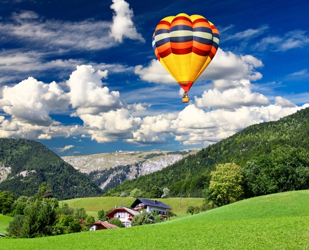 Landscape - balloons, splendor, hot air balloon, beautiful, hot air balloons, balloon, blue, pretty, view, beauty, landscape, house, grass, mountains, green, trees, colorful, sky, colors, lovely, houses, clouds, nature, peaceful, hills