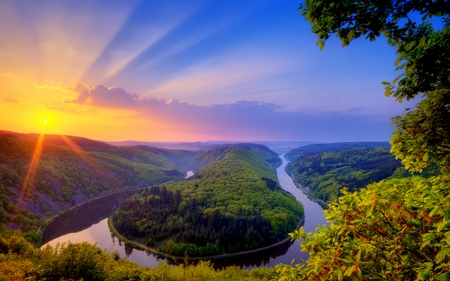 Beautiful Place - splendor, scenery, flowers, reflection, water, germany, mountain, forest, green, sunrise, saar, trees, sunlight, saarschleife, sundown, clouds, peaceful, shine, hill, glow, beautiful, river, horizon, tree, view, beauty, landscape, sunset, meandering, photo, woods, scene, summer, riverbank, rays, colorful, sky, dazzling, colors, lovely, island, photography, nature, sun, bushes, stream