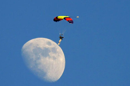 Parachutist landing on the moon - man, other, sky, moon