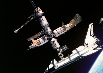 ATLANTIS DOCKED TO THE MIR SPACE STATION - orbit, space, spacestation, shuttle, docked