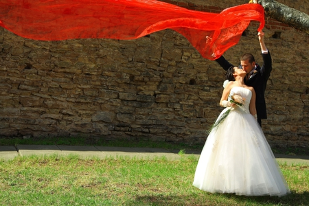 til the end - beauty, man, woman, white, love, red, wedding, couple, black, lovers, tux, groom, gown, outdoors, photography, bride, nature, marriage, romance, dress