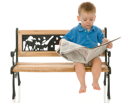 Cute boy setting on bench reading newspaper - Other & People ...